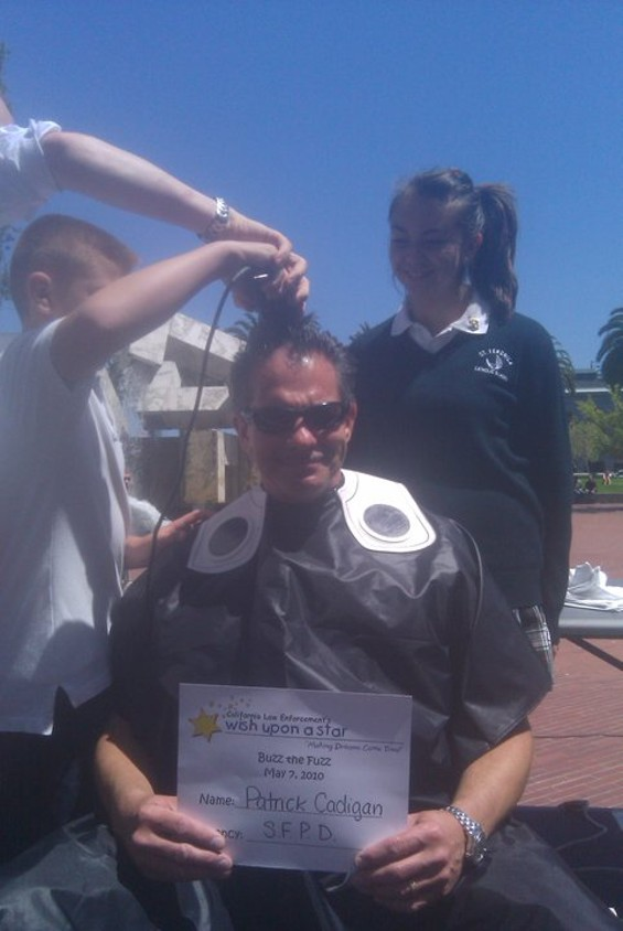 Inspector Patrick Cadigan gets shaved -- with a little help from his kids