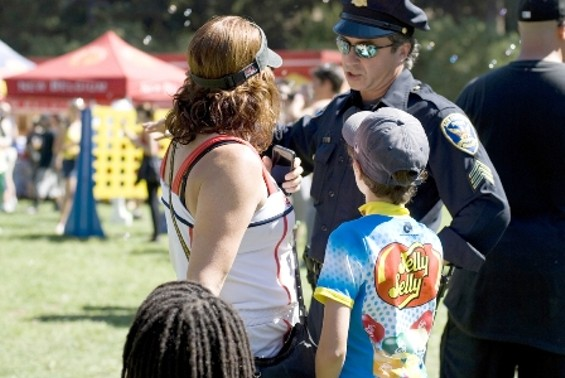 It was this poor cop's duty to protect kids from juggling and tightrope acts - MELISSA DE MATA WWW.MELISSADEMATA.COM