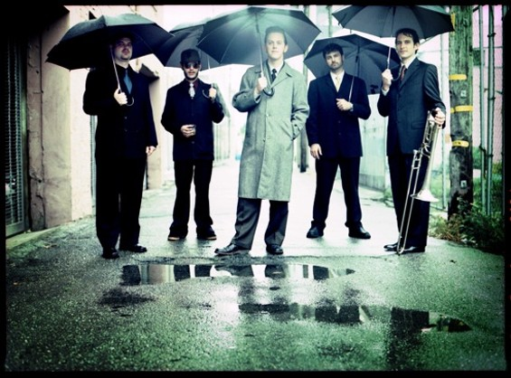 Jazz Mafia's Shotgun Wedding Quintet, with MC Dublin in the middle, and Adam Theis on the far right.