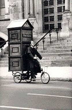 COURTESY OF JOEY SKAGGS - Joey Skaggs with his Porta Potti-inspired - Itinerant Confession Booth at the - Democratic National Convention in 1992, - from Pranks!