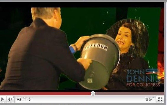 """John Dennis tosses a bucket of water on Nancy Pelosi, """"the wicked witch of the west"""" in an online campaign ad"""