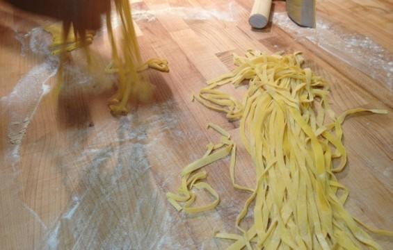 John Pauley of Mattarello defly cuts tagliatelle pasta. - ANNA ROTH