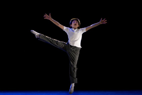 J.P. Viernes, as Billy Elliot, does things we can't. - JOAN MARCUS