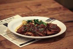 GABRIELLE LURIE - Juicy braised brisket is one of many reasons to have dinner and not just lunch at Wise Sons Deli.