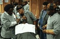 TRACY  BENNETT - Just a Little Off the Top: Cedric the Entertainer (far - left) shows the boys how to give a proper - shave-and-a-haircut.