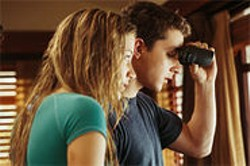 PARAMOUNT PICTURES - Kale (Shia LaBeouf) and Ashley (Sarah Roemer) spy on a neighbor they think might be a killer.