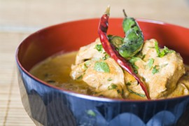 Kerala chicken curry with charred chile and coconut milk.