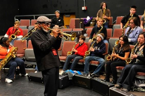 """Khalil Shaheed of Oaktown Jazz Workshops leading the """"Jazz Band and Improvisation"""" workshop."""