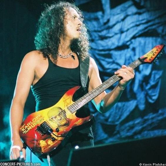 Kirk Hammett strums his guitar with a little help from Boris Karloff.