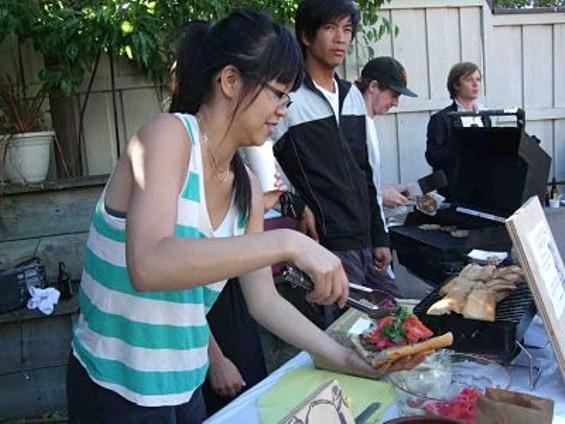 KitchenSidecar working on banh mi burgers. - TAMARA PALMER