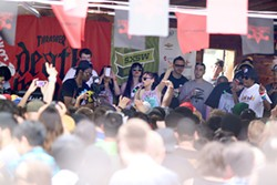 MARCO TORRES/MARCOFROMHOUSTON.COM - Kreayshawn, though barely visible above the heads of the crowd, showed improved live presence at SXSW.