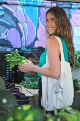 Krista Simmons peruses the seasonal produce at the farmers market. - FELICIA FRIESEMA/FIG STUDIO