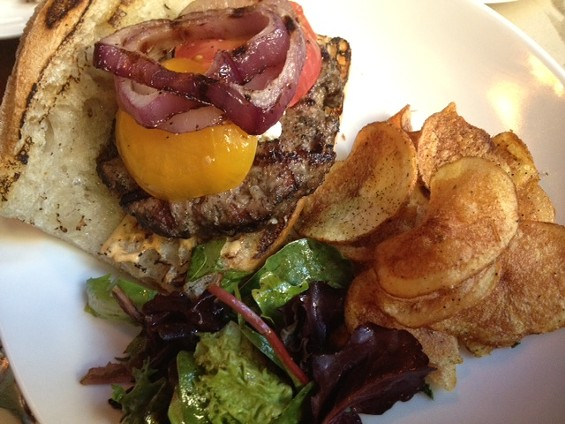 Lamb burger with goat cheese, heirloom tomato, caramelized onion and Machka curry chips. - TAMARA PALMER