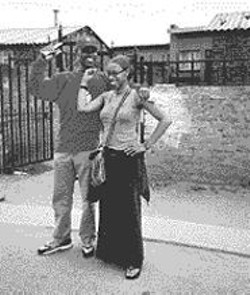 Lateefah Simon clowns around with a friend - on a good-works visit to South Africa.