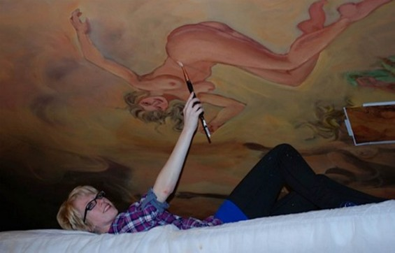 Lay lady lay! Skramstad works from her scaffolding on Gold Dust's new mural