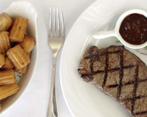 Leatherneck's own tater tots with a grilled New York strip. - LARA HATA
