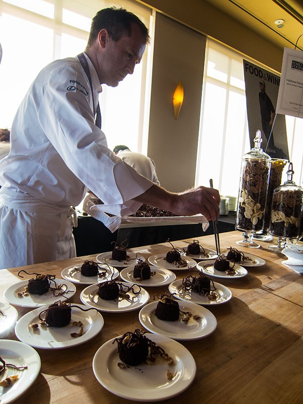 Lincoln Carson plates his dessert at the Pebble Beach Food & Wine opening party. - THE DAPPER DINER