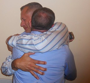 Luis Juarbe grows emotional as he embraces his partner, Mike Reardon -- but his euphoria over the lifting of the stay on Prop. 8 was premature - JOE ESKENAZI