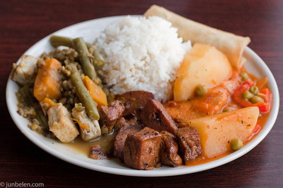 """Lunch plate at Oakland's No Worries, featuring afritada (right) made from soy """"chicken."""" - JUN BELEN"""