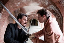 MARK & TRACY PHOTOGRAPHY - Macduff (Benjamin Stowe) and Macbeth (Mackenszie Drae) hack it out around innocent, ticket-holding bystanders.