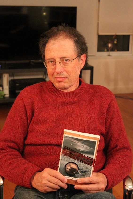 Malcolm J. Brenner, with his book, Wet Goddess - MATT SAINCOME