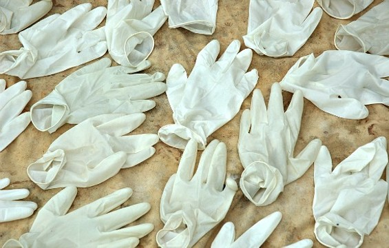 Many worry the new disposable glove law will result in a lot of waste. - FLICKR/JULIEN HARNEIS