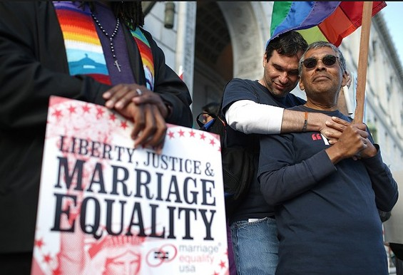Mark Guzman, right, and Scott Coatsworth during a marriage equality rally March 26 in San Francisco - JUSTIN SULLIVAN