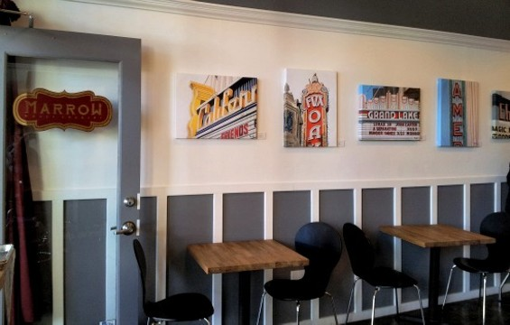 Marrow is decorated in part with photos of Oakland. - PETE KANE