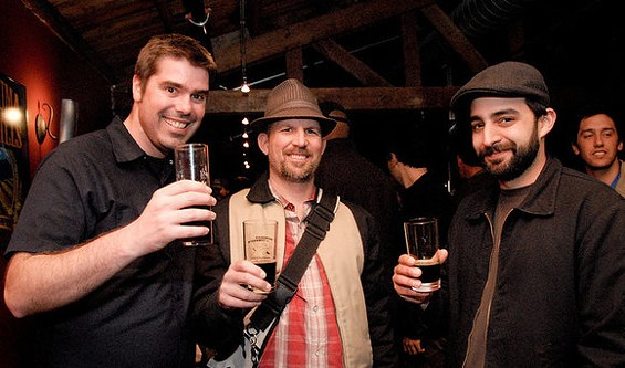 Master cicerone Rich Higgins, left, hoists one at the Breweries of Tomorrow event. - BITTERMELON/FLICKR