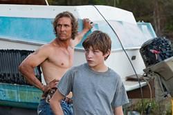 Matthew McConaughey and some kid (Tye Sheridan) blocking the view of McConaughey.