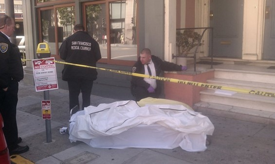 Medical examiners prepare to transport the mortal remains of Mario Hernandez from Valencia Street - JOE ESKENAZI