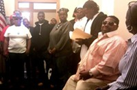 Members of Aboriginal Blackmen United wait for a meeting with City Administrator Ed Lee