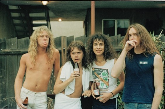 Metallica in the backyard of its house on San Pablo Ave. in El Cerrito. Photo by Harald Oimoen, from the book Murder in the Front Row: Shots From the Bay Area Thrash Metal Epicenter.