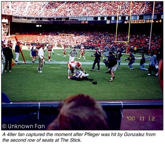 Mickey Pfleger is down for the count after being bulldozed by Tony Gonzalez