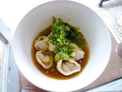 ALEX HOCHMAN - Mission Chinese Food's pork dumplings in ham broth.