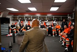 "JOSEPH SCHELL - Moments before the Bulls' opening game, owner Shmuel Farhi tells the team, ""I have a lot of faith in you — work together and kick some ass!"""