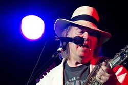 Neil Young helped raise $3 million for a new children's hospital on Wednesday night.