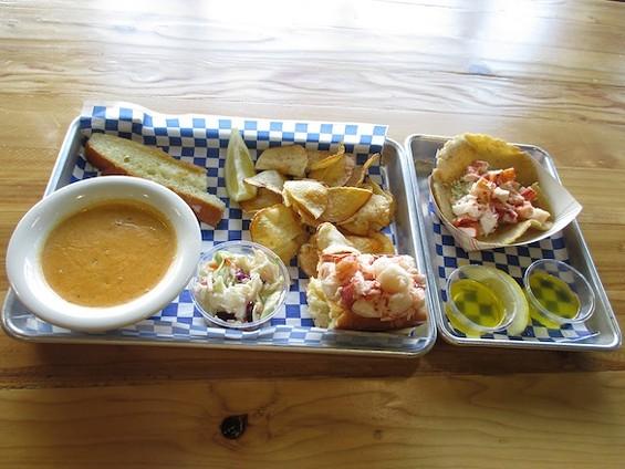 New England Lobster Market & Eatery's lobster chowder, lobster roll, and lobster taco. - TREVOR FELCH