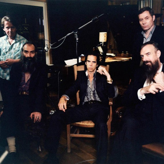 Nick Cave (center) and the Bad Seeds