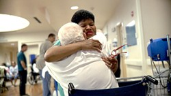 Nurse Assistant Cynthia Y. Johnson administers care at Oakland's Highland Hospital in the medical-system documentary The Waiting Room.