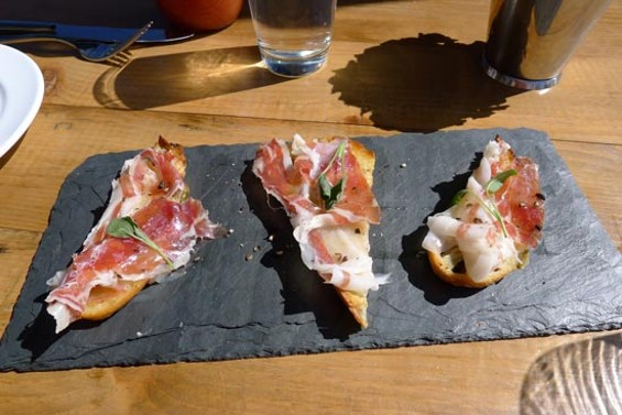 Olive bread toast, butter and prosciutto