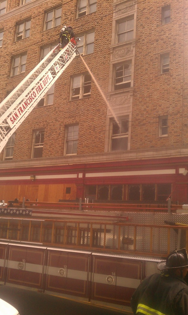 One of several beams of water being directed into the shuttered hotel. - JOE ESKENAZI