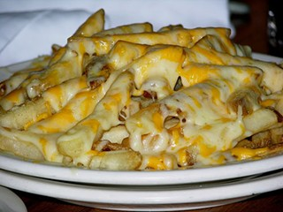 Outback's Aussie Cheese Fries: Likely to make you feel a tad sweaty down under. - GI VARGA./FLICKR
