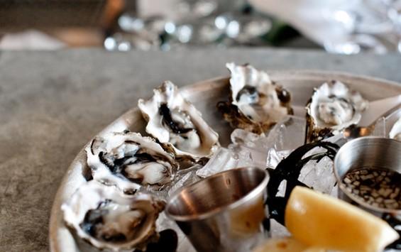 Oysters on the half-shell at Bar Crudo, $1 each. - ALBERT LAW/PORKBELLYSTUDIO.COM