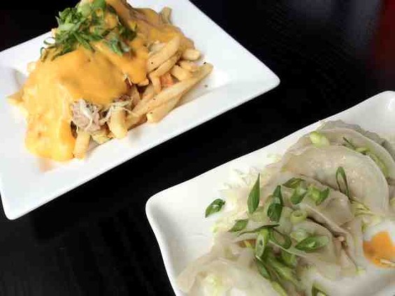 Pa'ina's Kalua pig cheese fries and Oh My Gyoza! - TAMARA PALMER
