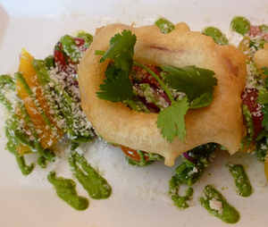Papito's onion ring-topped heirloom tomato and cactus salad. - ALEX HOCHMAN