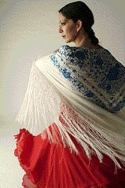 PAUL  TRAPANI - Part Diva, Part Bullfighter: Yaelisa displays her - embroidered mantn, used for enhancing flamenco - rather than enticing bulls.