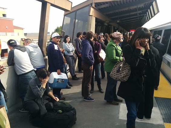 Passengers dumped on the platform after waiting aboard the train for an hour. - ERIN SHERBERT