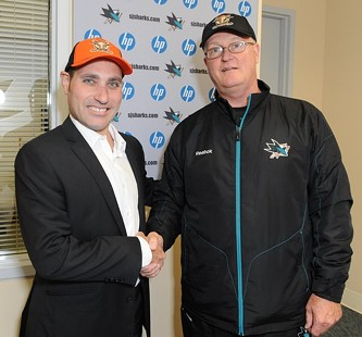 Pat Curcio and Sharks' Assistant General Manager Wayne Thomas grip and grin