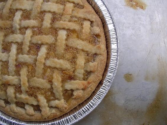 Peach pie, made with Frog Hollow fruit, $12. - JOHN BIRDSALL